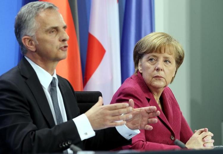 Merkel: Keine raschen Konsequenzen nach Schweizer Votum (© 2014 AFP)