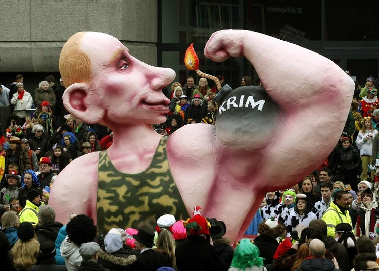 Putin mit brennender Bombe als Bizeps (© 2014 AFP)