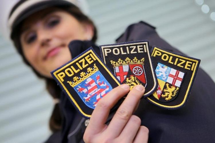 Drei Bundesländer mit einheitlichen Polizei-Uniformen  (© 2014 AFP)