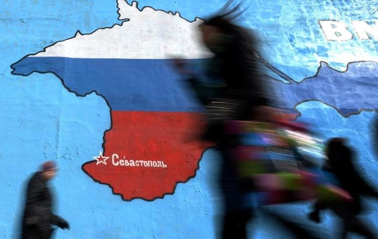 Merkel droht Russland erneut mit Wirtschaftssanktionen (© 2014 AFP)