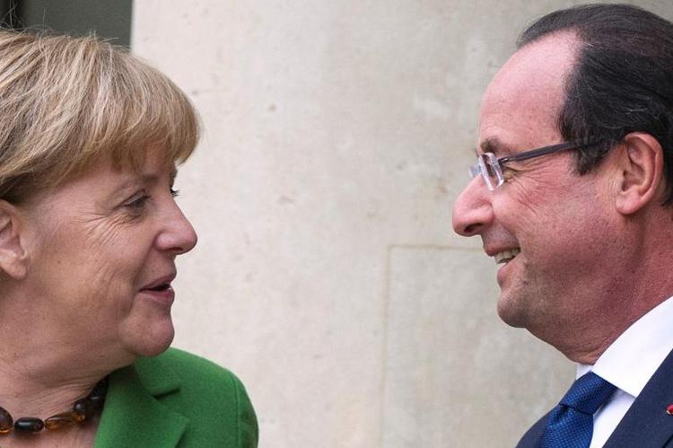 Merkel empfängt Hollande an der Ostsee (© 2014 AFP)