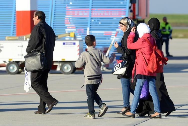 Aktivisten fordern Aufnahme von mehr Flüchtlingen (© 2014 AFP)