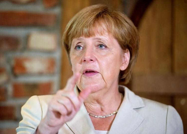 Merkel in EU-Debatte für Verhandlungen mit London offen (© 2014 AFP)