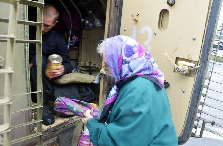 Berlin stockt humanitäre Hilfe für Ukraine auf (© 2014 AFP)
