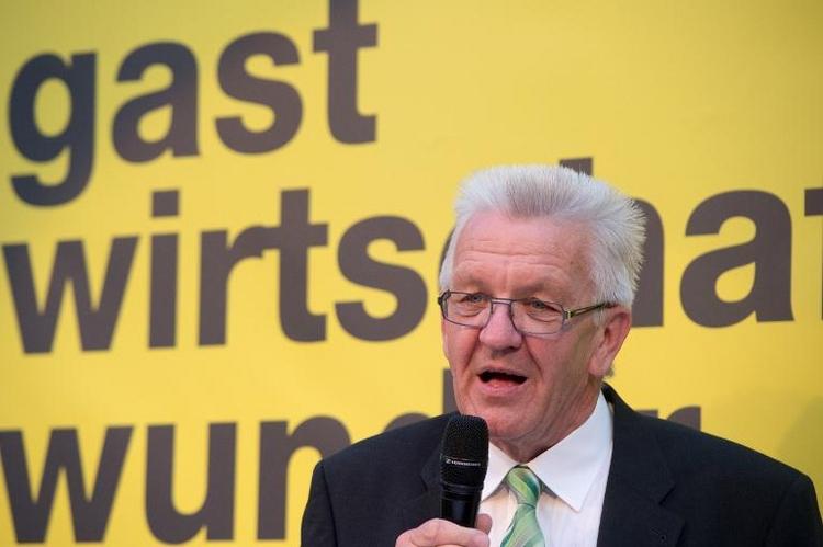 Kretschmann: Soli nach 2019 als Teil der Einkommensteuer (© 2014 AFP)