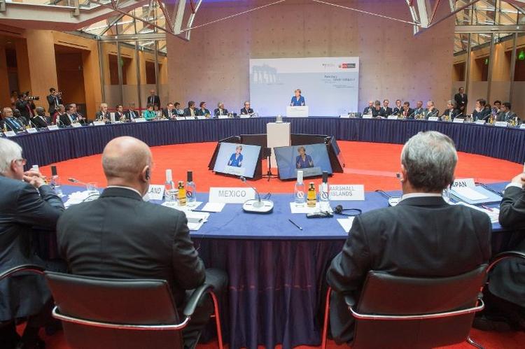 """Merkel ruft Staaten beim Klimaschutz zu """"Kehrtwende"""" auf (© 2014 AFP)"""