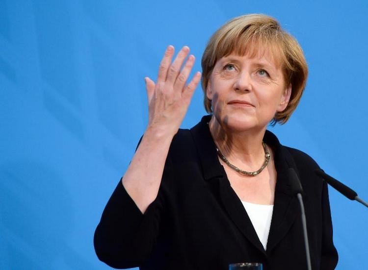 Merkel zieht Zwischenbilanz der großen Koalition (© 2014 AFP)