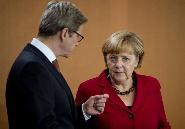 Merkel wünscht Westerwelle gute Besserung (© 2014 AFP)