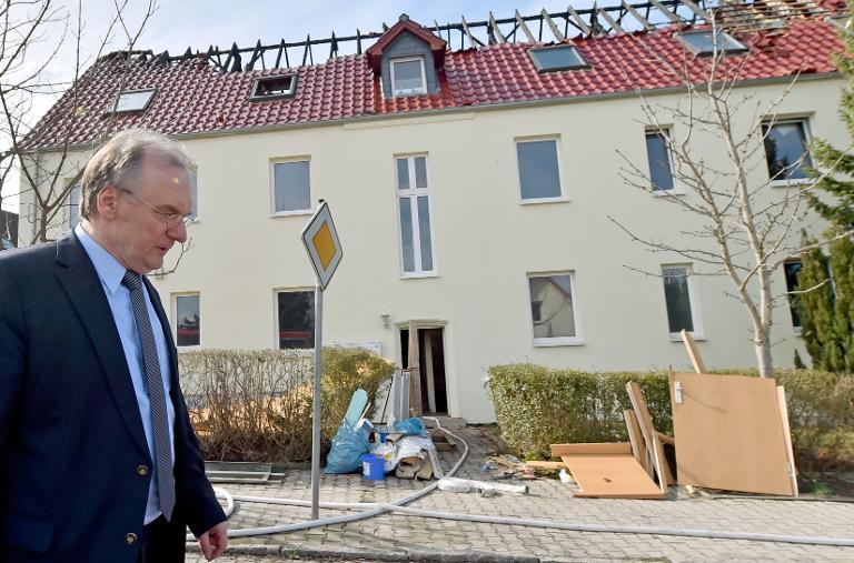 """Haseloff: """"Tröglitz ist überall"""" (© 2015 AFP)"""