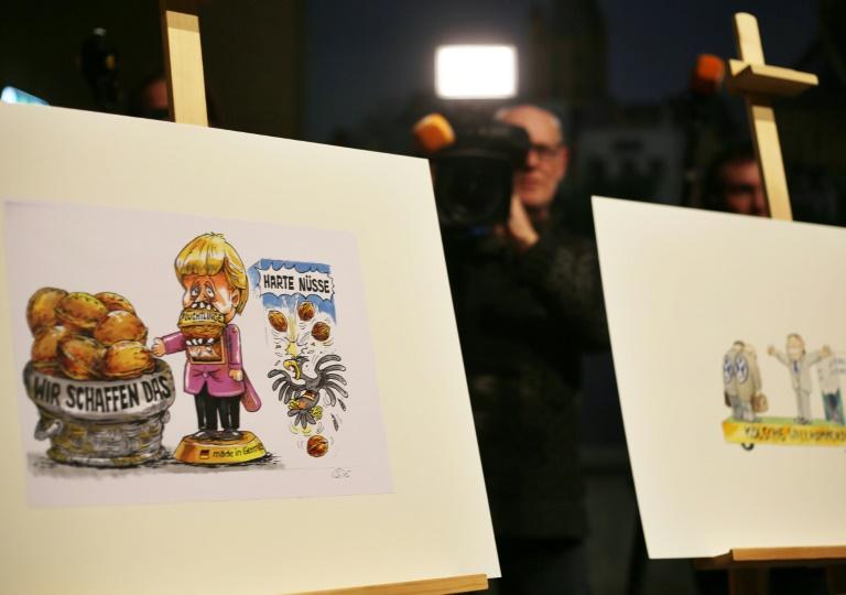 Kölner Karnevalisten machen Merkel Rosenmontag zur Nussknackerin (© 2016 AFP)