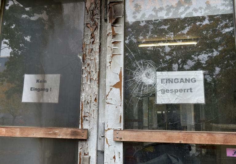 2015 mehr als tausend Attacken auf Flüchtlingsheime (© 2016 AFP)
