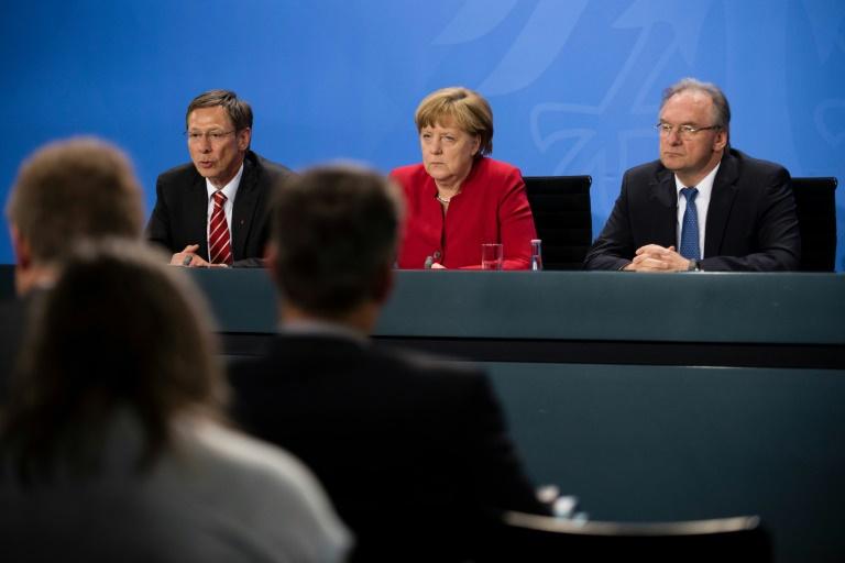 Merkel und Ministerpräsidenten beraten über Integrationskosten und Energiewende (© 2016 AFP)